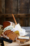 Slices of tasty rye bread, camembert cheese, roquefort and knife Royalty Free Stock Images