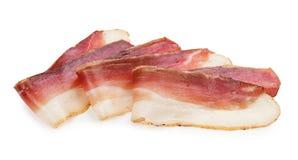 Slices of tasty spanish ham on white background Stock Image