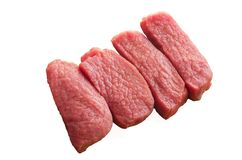 Slices of tenderloin of raw beef isolated on the white backgroun Royalty Free Stock Image