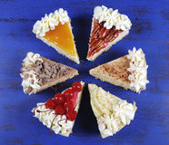 Slices of Thanksgiving Pie on dark blue wood Stock Photo