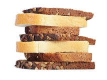 Slices of three kinds of bread close up. Three kinds of bread. Isolated over white Royalty Free Stock Photo