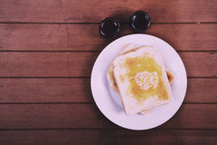 Slices of toast against a rustic background Vintage Retro Filter Royalty Free Stock Images