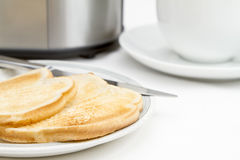 Slices of toast with toaster Royalty Free Stock Images