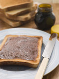 Slices of Toast with Yeast Extract Spread Stock Images
