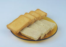 Slices of toasted biscuit and sunflower halvah. Toast biscuit, breakfast wonderful idea, especially combined with caviar, halva and buter Royalty Free Stock Photography
