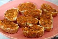 Slices of toasts with tomato and vegetable confit Stock Photos