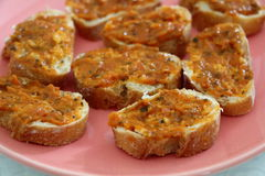 Slices of toasts with tomato and vegetable confit Stock Images