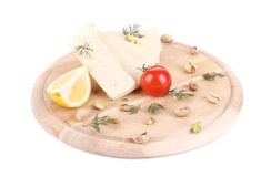 Slices of tofu on wooden platter. Royalty Free Stock Photography