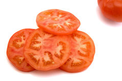 Slices of tomato. Isolated on the white background royalty free stock photography