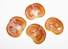 Slices of tomato. Cross section slices of ripe tomato, isolated on white background Royalty Free Stock Photo