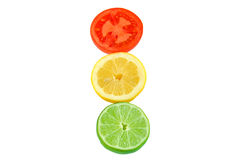 Slices of tomato, lemon and lime. Royalty Free Stock Image