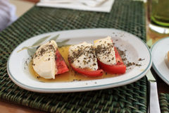 Slices tomatoes with cheese and pepper Stock Photo