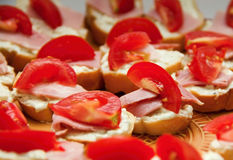 Slices with tomatoes. Slices of ham and cheese with tomatoes Royalty Free Stock Photography