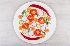 Slices of tomatoes, radishes, cucumbers and dill, peppers. On white glass plate. Top view Royalty Free Stock Images