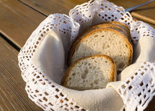 Slices of traditional bread on handmade napkin in basket  Royalty Free Stock Photography