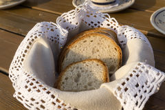 Slices of traditional bread on handmade napkin in basket Stock Photo