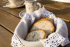 Slices of traditional bread on handmade napkin in basket  Stock Image