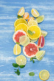 Slices of various citrus fruits Stock Photos