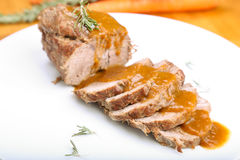 Slices of veal roll with sauce Stock Images