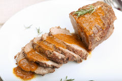 Slices of veal roll with sauce. Royalty Free Stock Photo
