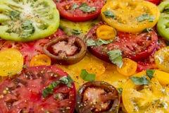 Slices of vine ripe tomato varieties Royalty Free Stock Photos