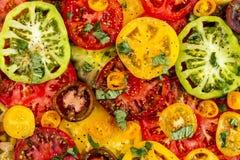 Slices of vine ripe tomato varieties Royalty Free Stock Image