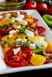 Slices of vine ripe tomato varieties Stock Photos