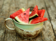 Slices of watermelon in big cup Royalty Free Stock Photo