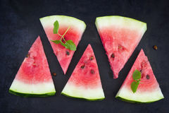 Slices of watermelon on a black background, top view Royalty Free Stock Photo