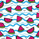 Slices of watermelon on cartoon waves background. Seamless pattern in hand drawn style. Blue, pink, green, black outline Royalty Free Stock Photography
