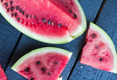 Slices of watermelon  on a dark wooden background, top view Royalty Free Stock Photos