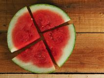 Slices of Watermelon, flat lays on wood background Stock Photography