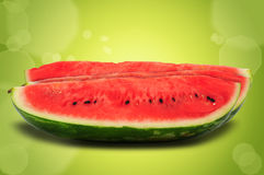 Slices of watermelon on green background Stock Photography