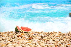 Slices of watermelon at seashore Royalty Free Stock Photos