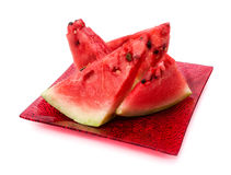 Slices of watermelon. Are in a square plate on a white background Royalty Free Stock Images