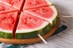 Slices of watermelon on a stick close up on the table. horizonta. Slices of fresh watermelon on a stick close up on the table. horizontal Royalty Free Stock Photo