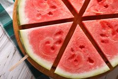 Slices of watermelon on a stick macro. Horizontal top view Stock Image