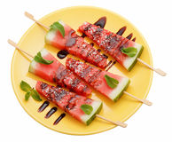 Slices of watermelon with stick on yellow plate  on whit Royalty Free Stock Photography