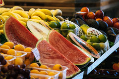 Slices of watermelon and various fruit at the market Stock Image