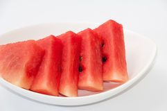 Slices of watermelon in the white bowl Stock Images