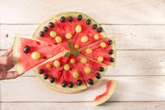 Slices of watermelon on wooden table Stock Photo