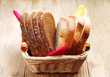 Slices wheat and rye bread in a basket Stock Images