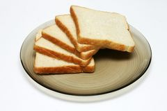 Slices of White bread. On a plate against a white background Stock Image