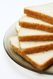 Slices of White bread. On a plate against a white background Royalty Free Stock Photos