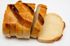 White bread slices, gray background. Slices of white bread, even cut. Bread made of white wheat contains gluten. The crust is over cooked Royalty Free Stock Photo
