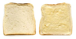 Slices of White Bread Isolated Top View Buttered and Unbuttered. Slices of white bread, isolated, buttered and unbuttered. Top view Stock Image