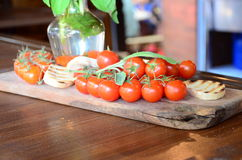 Slices of white toasted bread with a bunch of tomatoes Royalty Free Stock Images