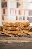 Slices of whole bread on wooden table Stock Photo
