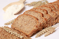 Slices of a whole wheat bread. Whole wheat bread cut on slices stock image