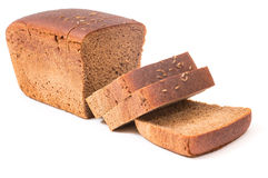 Slices of wholemeal bread. Over rustic background Stock Image